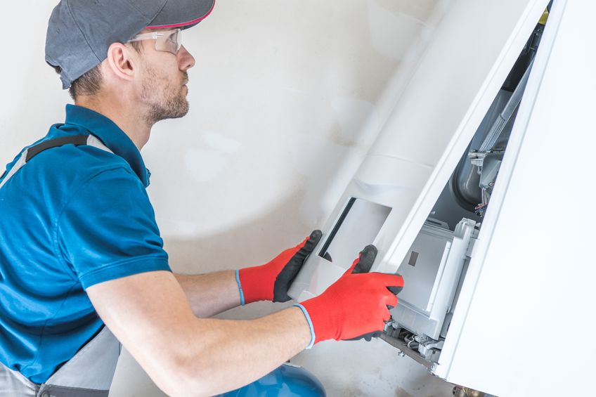 House Heating Unit Repair by Professional Technician.