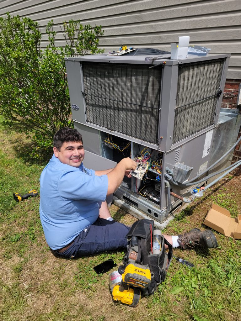 Home Town Owner Servicing a HVAC Unit