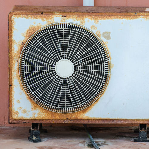 old air conditioning with rust